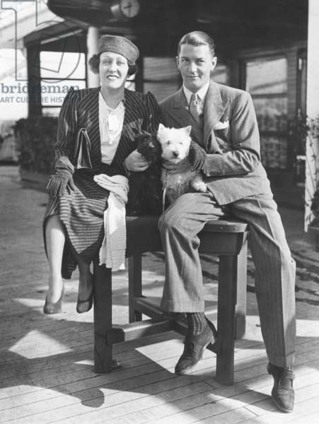 Gloria Swanson with her husband, Michael farmer, her 4th husband. March 16, 1933. They arrived in NYC after she produced the English film, PERFECT UNDERSTANDING. It did not revive her movie career as hoped. Swanson was married to Farmer from 1931 to 1934. They had one child, Michelle Bridget Farmer