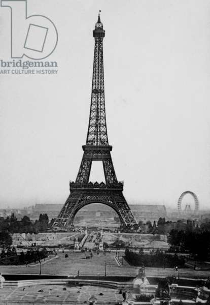 Tour Eiffel: The Eiffel Tower with The Great Wheel of the Universal Exhibition in the background, c. 1900.