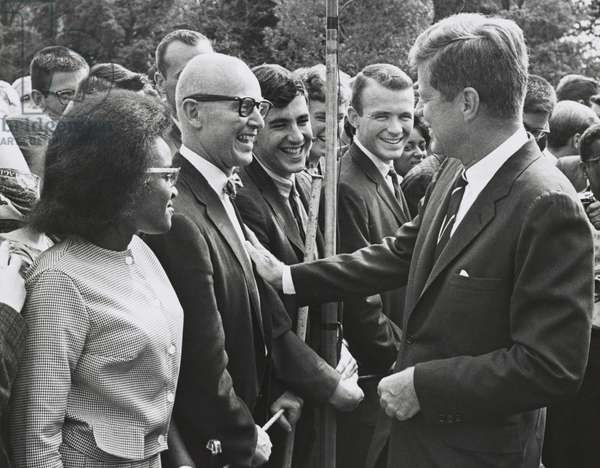 President John Kennedy meets with one of the first groups of Peace Corps volunteers. White House lawn, Aug. 21, 1961