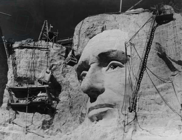 Face of Abraham Lincoln under construction on Mount Rushmore, South Dakota, 1938. Photo by Charles d'Emery
