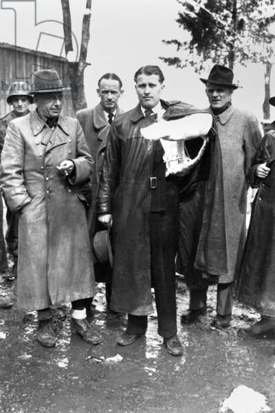 Wernher von Braun (with arm cast), inventor of the V-2 rocket, after surrendering to U.S. Troops, 1945