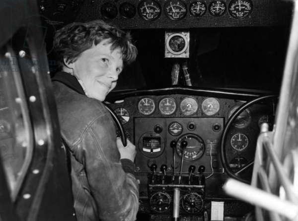 Amelia Earhart in her Lockheed L-10E Electra prepares for 27,000 mile globe flight, Alameda, CA, 1937