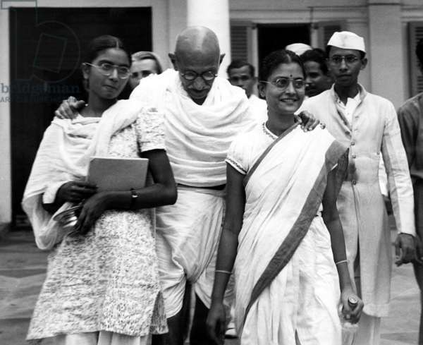 Mahatma Gandhi, at age 70, with his two grandaughters. c. October 1939