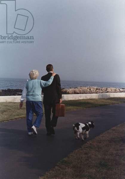 President George and Barbara Bush walk as Millie trots alongside Walker's Point Kennebunkport Maine. Aug. 16 1989