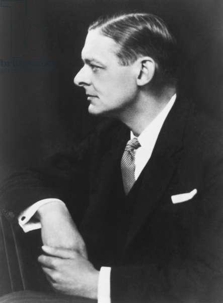 T. S. Eliot, American born British poet, critic and dramatist. Photo by Elliott & Fry, c. 1925. -
