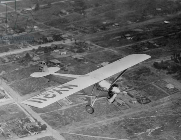 Charles Lindbergh flying his plane 'The Spirit of Saint Louis' from New York to Paris, c.late 1920s