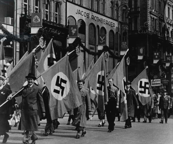 Nazis parade in Vienna, Austria, on May Day, 1938. The Anschluss with Nazi Germany violated of the Treaty of Versailles. It was 6 weeks since the annexation, Britain made 'grave warnings' but took no military action