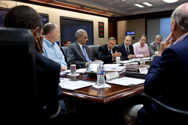 CIA Director David Petraeus speaking during a National Security meeting as Obama (left) listens. Situation Room of the White House, Sept. 10, 2011