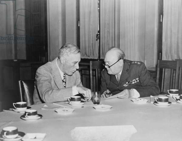 President Roosevelt huddles with his ally, Prime Minister Churchill, during the Yalta conference. February 1944