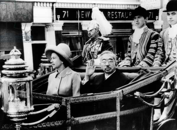 Queen Elizabeth and Emperor Hirohito, ride a carriage from Victoria Station to Buckingham Palace. London, England. October 1971.