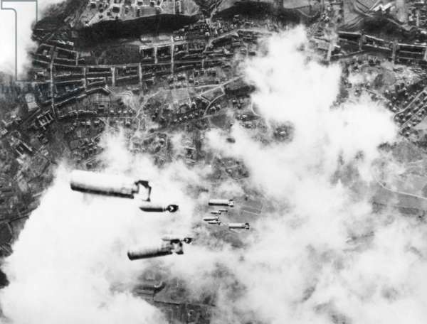 Incendiary bombs fall toward the city of Dresden, Germany. U.S. 8th Air Force heavy bombers attacked the Saxony capital following the RAF night bombings. 2nd Feb. 1945