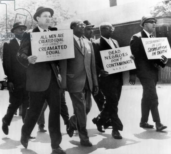 Demonstrators picket at Oak Woods Cemetery in Chicago. The cemetery refused to cremate a black woman's body, 1963