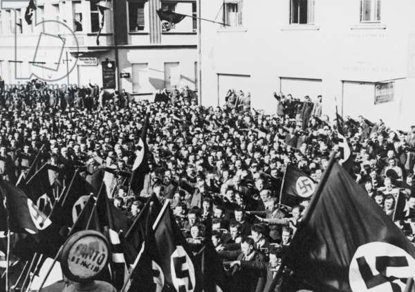 Crowd in Oberwart, Austria, saluting Nazi flags celebrating the Anschluss of Austria. March 11, 1938