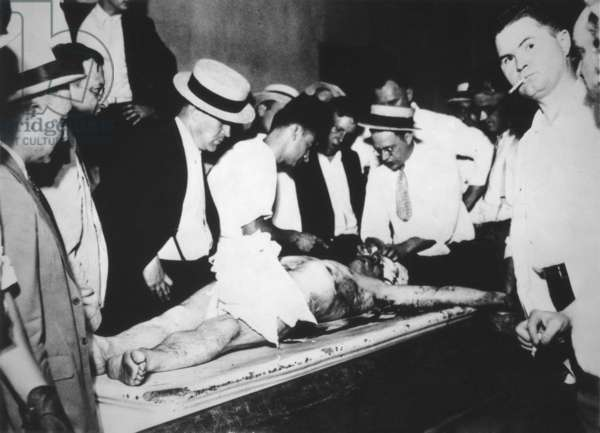 John Dillinger's bloody corpse in the Chicago County morgue. He was shot outside a theater by FBI agents on July 22, 1934