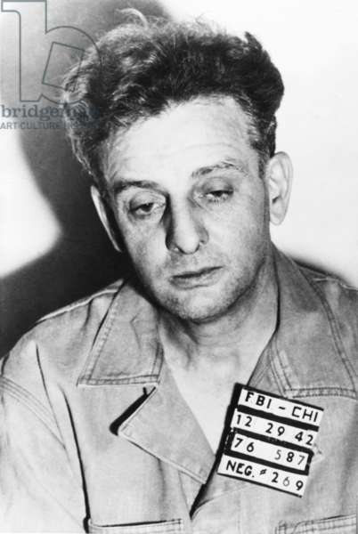 Roger 'Terrible' Touly, surrendered to FBI shortly after G-men killed two members of the gang. He was arrested with Basil Banghart in Chicago on Dec. 29, 1942. He had been at-large since escaping from Statesville prison last Oct. 9, 1942. In 1934 he was imprisoned for the kidnapping of gangster, John Factor. He was framed by Factor and Al Capone, who arranged to fake the kidnapping implicating Touhy, to assume control over his gambling organization