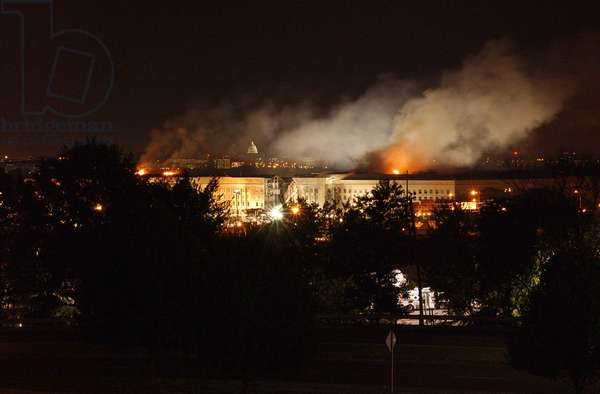 Night view of the Pentagon with the Capitol in the background on September 11 2001. Earlier in the day Al-Qaeda terrorists crashed a jetliner into the building killing 64 passengers and 125 others on the ground., Photo by:Everett Collection