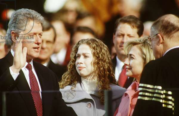 BILL CLINTON being sworn in at second inauguration, Chelsea Clinton(c), & Hillary Clinton(r), January 20, 1997