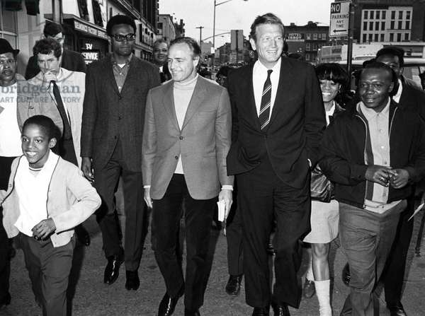 Marlon Brando, Mayor John Lindsay tour the streets of Harlem in the late 1960s