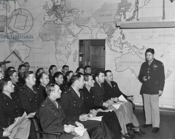 Major General Curtis Lemay leads a meeting of Commanders of the 3rd Bomb Division, 8th Air Force. The date was June 5, 1944, the day prior to the Allied D-Day landings in Normandy. England, World War 2