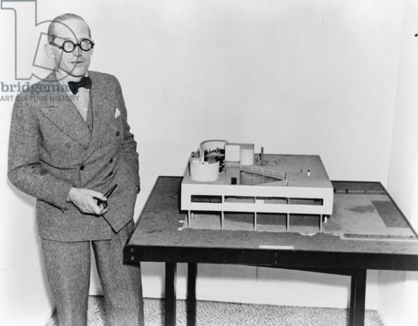 Le Corbusier (1887-1965), with an architectural model of his Villa Savoye, which was built at Poissy, France (1929–31). 1935 photo
