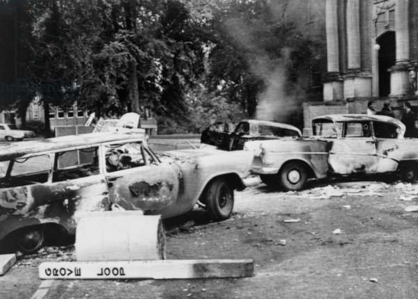 Segregationist riot at Old Miss. Burned out cars at University of Mississippi campus after a night of violence protesting the admission of James Meredith, an African American student. Oct. 1, 1962