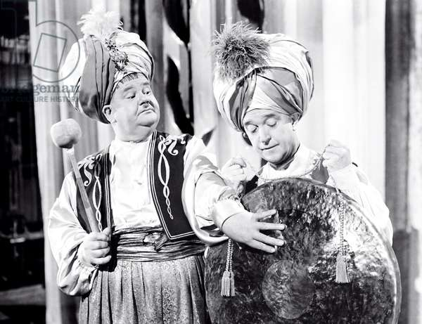 A-HAUNTING WE WILL GO, from left, Oliver Hardy, Stan Laurel, 1942