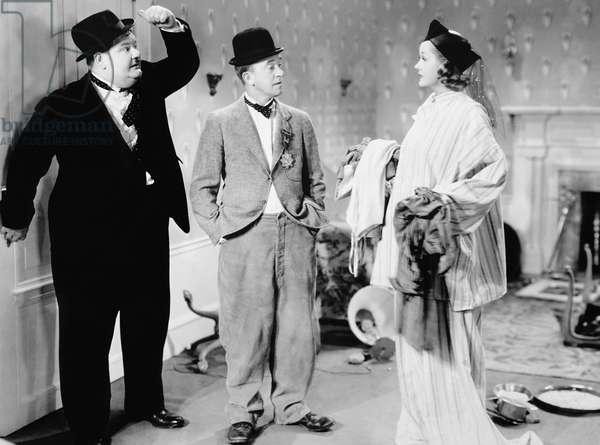 BLOCK-HEADS, from left: Oliver Hardy, Stan Laurel, Patricia Ellis, 1938