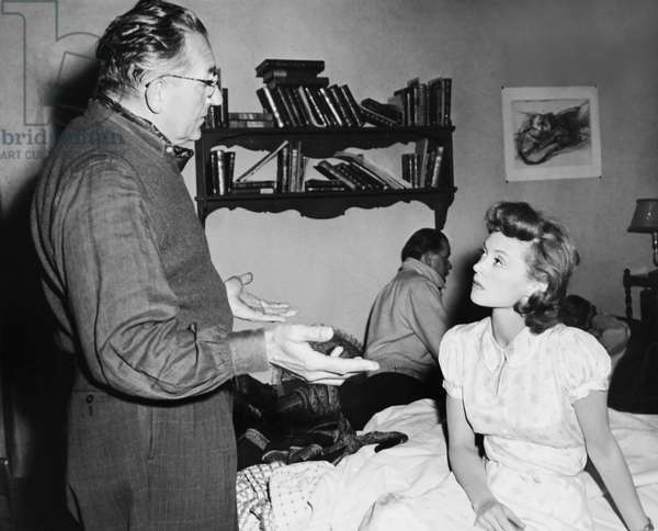 CLOAK AND DAGGER, from left: director Fritz Lang, Lillli Palmer on set, 1946