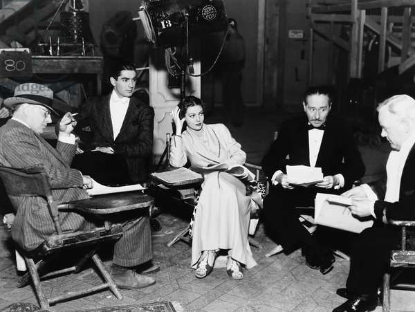 CAFE METROPOLE, from left: director Edward H. Griffith, Tyrone Power, Loretta Young, Adolphe Menjou, Charles Winninger on set, 1937