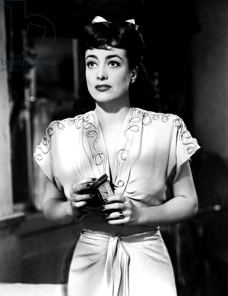 ABOVE SUSPICION, Joan Crawford, in a dress designed by Irene, 1943