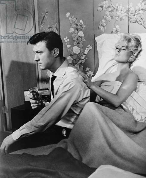 A GIRL NAMED TAMIKO, from left: Laurence Harvey, Martha Hyer, 1962