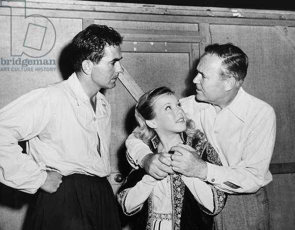 THE BLACK ROSE, from left: Tyrone Power, Cecile Aubry, director Henry Hathaway on set, 1950