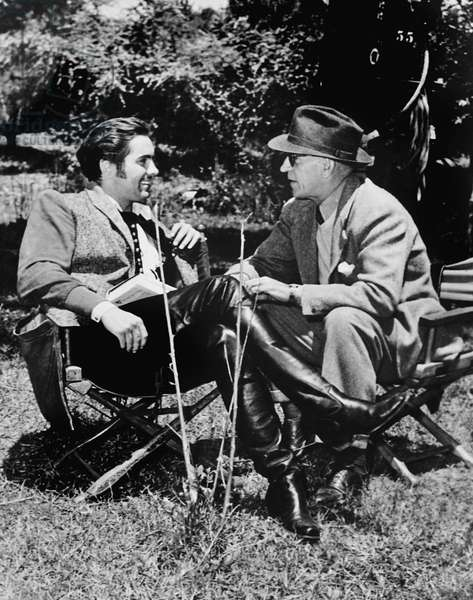 THE BLACK SWAN, from left: Tyrone Power, director Henry King on set, 1942