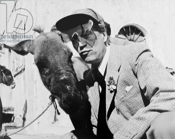 BEAT THE DEVIL, director John Huston and friend on location in Italy, 1953