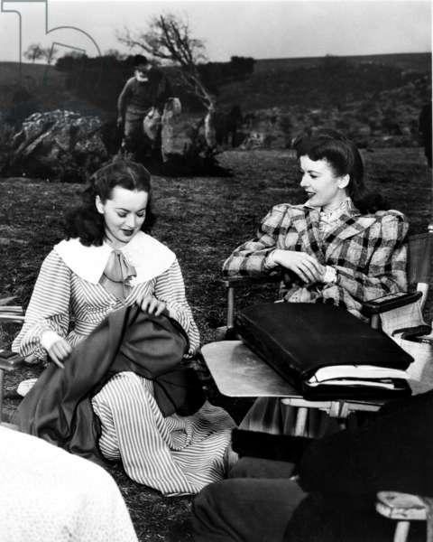 DEVOTION, from left, Olivia de Havilland, Ida Lupino, on location, 1946