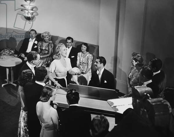 DOWN ARGENTINE WAY, Betty Grable (bare midriff), don ameche (seated) entertaining on set, 1940