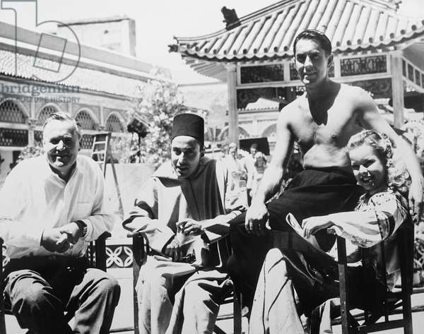 THE BLACK ROSE, from left: director Henry hathaway, Tyrone Power (barechester), Cecile Aubry on set, 1950