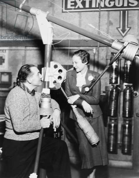 FURY, from left: director Fritz Lang, Sylvia Sidney on set, 1936