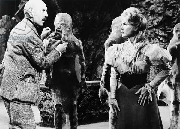 FIRST MEN IN THE MOON, from left: Lionel Jeffries, Martha Hyer, 1964