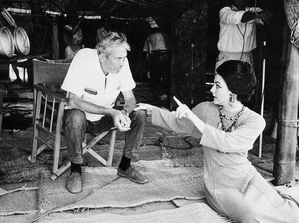 THE BIBLE, from left: director John Huston, Ava Gardner on set, 1966