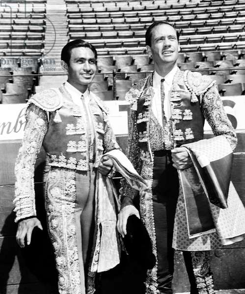 THE BRAVE BULLS, from left, matador Paco Rodriguez, Mel Ferrer, on location in Mexico City's Plaza Mexico, 1950