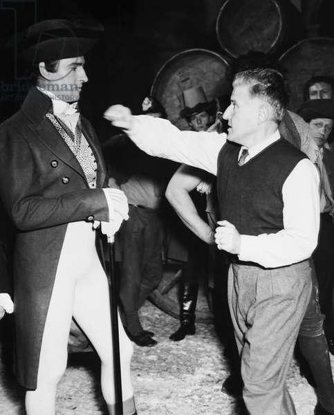 BEAU BRUMMEL, from left: Stewart Granger, director Curtis Bernhardt on set, 1954