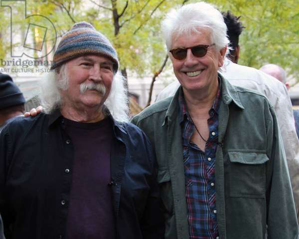 Former CSNY musicians David Crosby (l) and Graham Nash give a short acoustic concert in Zuccotti Park, home of the Occupy Wall Street movement. 11/8/2011 (photo)