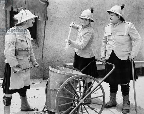 BONNIE SCOTLAND, from left: James Finlayson, Stan Laurel, Oliver Hardy, 1935