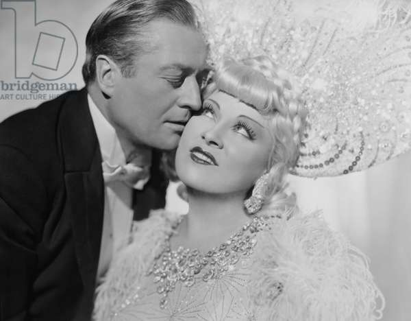 EVERY DAY'S A HOLIDAY, from left: Edmund Lowe, Mae West, 1937