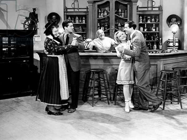 EVERYTHING HAPPENS AT NIGHT, from left, Jody Gilbert, Robert Cummings, Paul Porcasi, Sonja Henie, Ray Milland, 1939