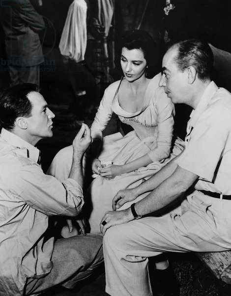 BRIGADOON, from left: Gene Kelly, Cyd Charisse, director Vincente Minnelli on set, 1954