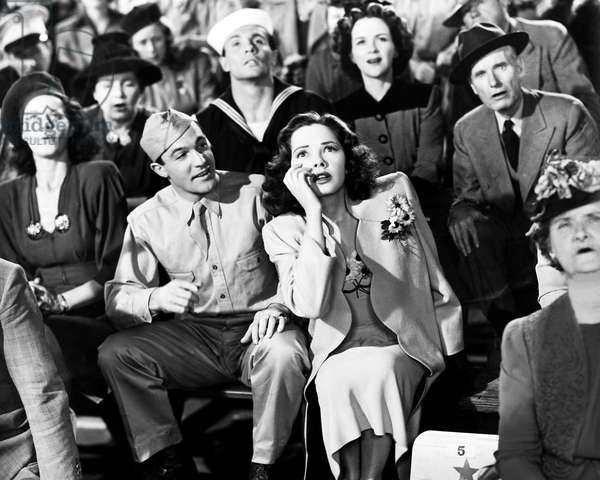 THOUSANDS CHEER, from left, center, Gene Kelly, Kathryn Grayson, 1943