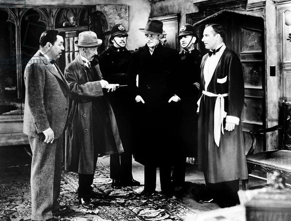 CHARLIE CHAN IN LONDON, from left, front, Warner Oland, E.E. Clive, Ray Milland, Alan Mowbray, 1934