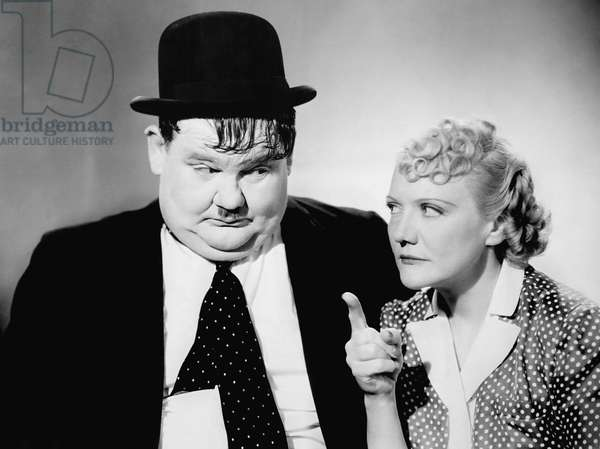 BLOCK-HEADS, from left: Oliver Hardy, Minna Gombell, 1938